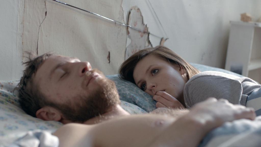 ELLEN IS LEAVING -Ellen (Tai Berdinner Blades) watches her boyfriend, Hamish, sleep